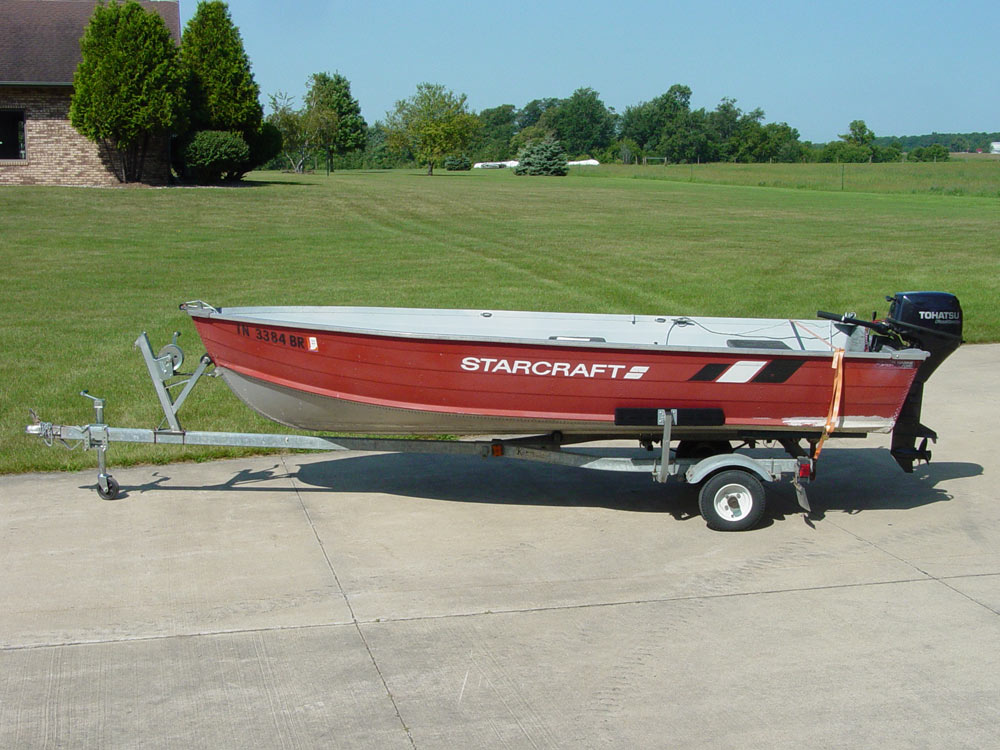 Multi-Estate Auction, Starcraft 14' aluminum fishing boat w/9.8hp Tohatsu four stroke engine and trailer